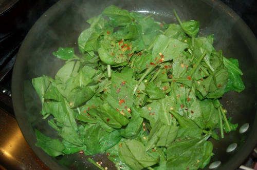 saute spinach with oil and pepper flakes for 1 minute..
