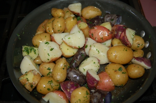 Toss potatoes into parsley butter