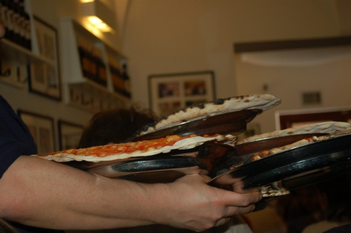 This waiter could carry any amount of pizza!