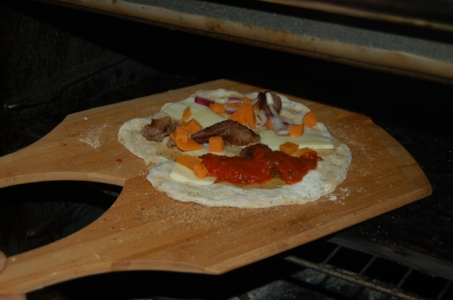 position pizza in the oven