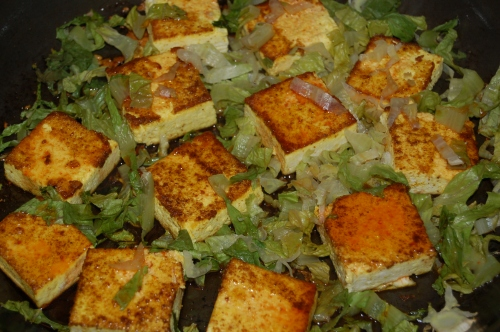 curry crusted fried tofu and sauteed escarole