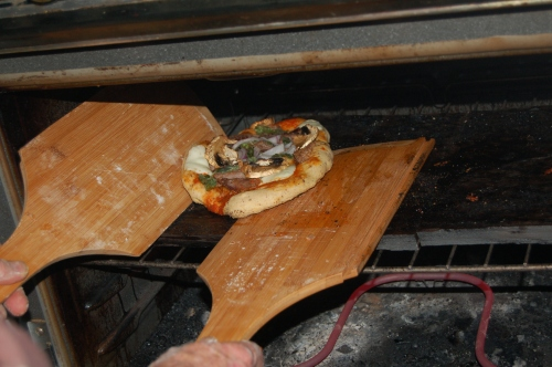 Retrieving the deliciously baked pizza is just as simple