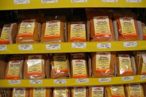 row upon row of curry powders