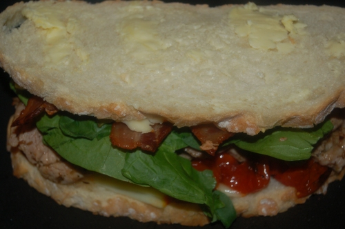 top with 2nd slice of bread mustard side down adn butter up. Press everything down ever so gently.