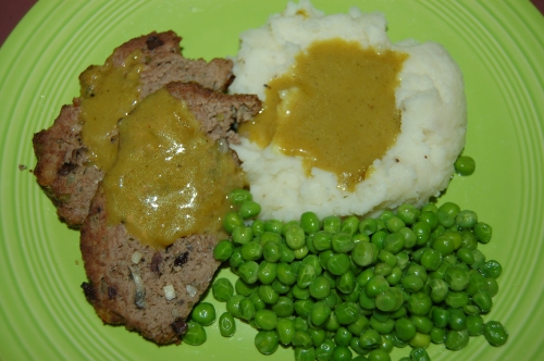 Flavorful Meatloaf with Curried Gravy, Mash & Peas