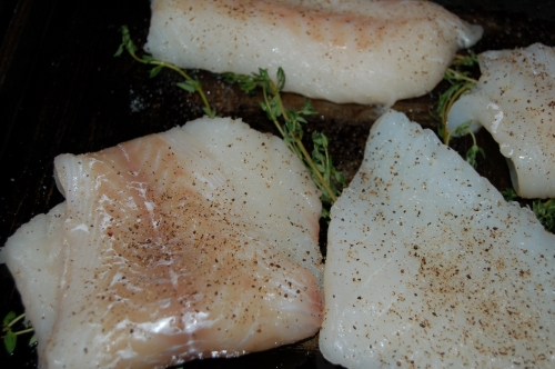 Arrange fish on baking tray with other ingredients