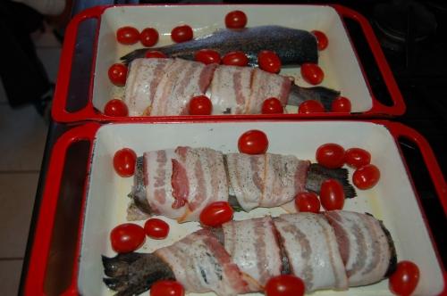 Wrap in bacon adn scatter tomatoes