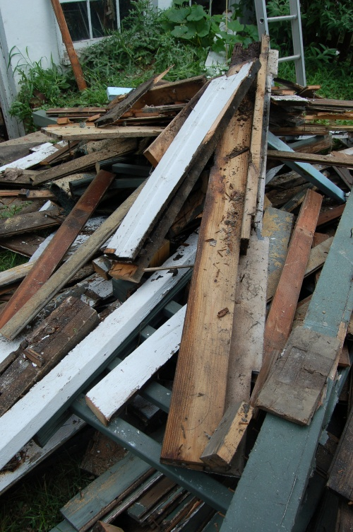 The back yard turned into one giant pile of nail-ridden, lead-paint covered wood scrapes