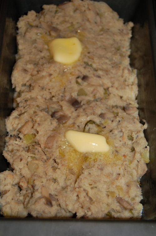 Place in loaf pan, add knob of butter and place in oven