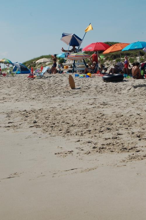 I love the colorful umbrellas strew along the beach