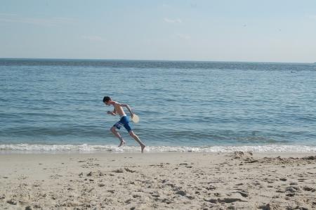 Calder running for the little blue paddle ball!