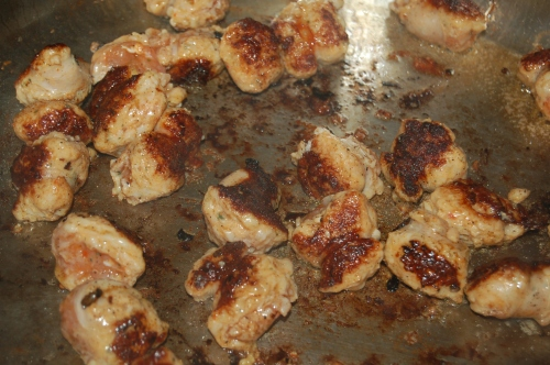 Sear sausage pieces
